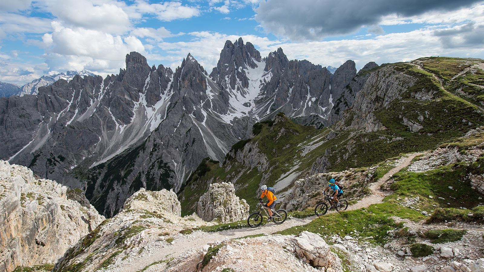 Tourists enjoy a day in the mountains with the bike rental in Badia